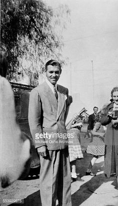 News Photo : Actor Clark Gable poses on the street in Los...