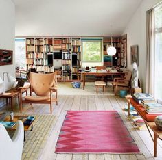 Living spaces book shelves living room midcentury mid century modern design decor interior george nelson bench eames knoll furniture 1950s 50s 1960s 60s Pendant Lamps table tables chairs armchair