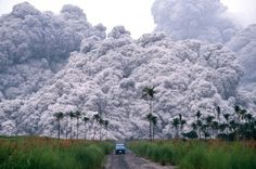 A pickup truck flees from the pyroclastic flows spewing from the Mt.Pinatubo volcano in the Philippines, on June 17, 1991. This was the second largest volcanic eruption of the 20th century
