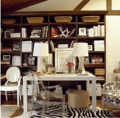 Acrylic chairs, zebra rug, bookshelves full of interesting things - we could work here!