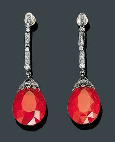 https://www.bkgjewelry.com/ruby-pendant/844-18k-yellow-gold-diamond-ruby-pendant.html Mexican fire opal and diamond earrings, mounted in platinum