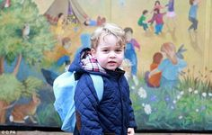 Prince George dressed in a navy quilted jacket and light blue rucksack grinned as he made his way into Westacre Montessori School near the family home, Anmer Hall in Norfolk
