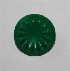 """Vintage Colt Firearms button - known as pattern #23 - bright green color - measures 3/4"""" at center - hourglass self shank with single injection mold mark.   Price $ 8.00"""