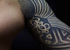 Pointillism tattoo by Nazareno Tubaro - This is a beautiful two sleeve tattoo design by Nazareno Tubaro. Most of his work is based on organic patterns that are inked in dots or lines.