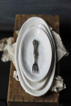 ironstone with fork!  :)  Maybe with a pair of old glasses or some personal item from the past!  ??
