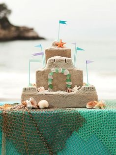 Gorgeous sand castle cake for a beach or ocean party.  LOVE!!
