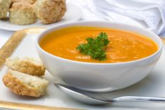 Curried Butternut Squash Soup - This butternut squash soup gets velvety texture from coconut milk and maximum flavor from ginger and spices. #teambeachbody #healthyrecipes