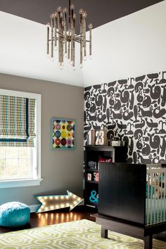 Shop the Look: Bold, Modern Nursery with Graphic Wallpaper >> http://photos.hgtv.com/rooms/viewer/bedroom/black-and-white/boy%27s-nursery-with-bold-patterns?soc=pinterest