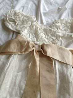 This is the sweetest little christening gown I've ever seen.  The ribbon is just lovely