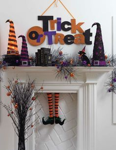 Halloween mantle LOVE the witch legs in the fire place!!!    :)
