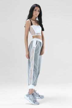 Classic tracksuit from our athleisure bestsellers! Your classic trackies with the perfect Nün Bangkok side mesh panel. These are so perfect because they are both winter friendly and summer friendly! *Cotton blend & mesh *Model is wearing size XS