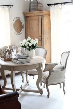 beautiful white cottage dining room area