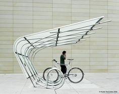 The Spokes Model Bike Shelter by Duo-Gard is covered bicycle shelter with an open design. Bike Shelter, Bus Shelters, Urban Furniture, Street Furniture, Furniture Nyc, Furniture Outlet, Furniture Design, Garage Velo, Pimp Your Bike