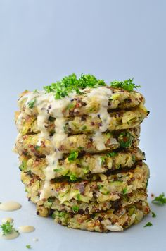 Greek Quinoa Zucchini Fritters!  Crispy zucchini fritters with a garlic-hummus sauce. Perfect for leftover zucchini! | www.delishknowledge.com