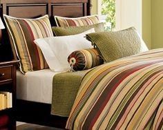 Duncan stripe bedding with green accent.