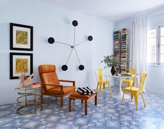 Gorgeous tiled floor blue living space with midcentury furniture