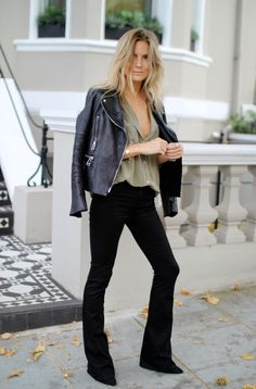 Are No Bra Outfits Trending? Signs point to YES - sexy olive colored shirt tucked into black flare legs jeans and topped off with a black moto jacket