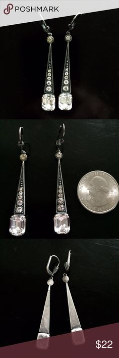 """Silver Metal Earrings, Vintage Silver metal vintage earrings. Graduated clear glass stones with striking facets are set into silver metal with lovely patina. Lovely carved inverted teardrops create a flattering dangle. They measure 2-1/2"""" from top to bottom. I bought them in 1984 and have treasured them. Excellent condition. Jewelry Earrings"""