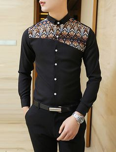Great patterned inset on a simple black shirt. Made even more interesting by the fact that it's lopsided!