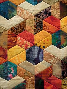 half hexie quilt - note the triangle block..careful placement of colors makes this look 3D