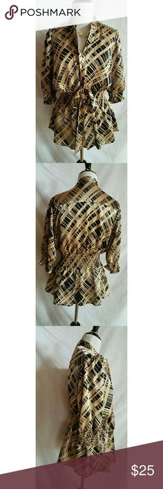 Bcbg Max Azria Size L Blouse 98% polyester,  2% spandex.   Ties in the front.   Hand wash.  Some minor snags, but still a beautiful top BCBGMaxAzria Tops Blouses