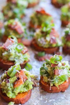 Roasted Sweet Potato Rounds with Guacamole and Bacon | http://theroastedroot.net #paleo #vegan #recipe #appetizer
