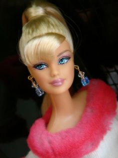 Barbie - I loved my Barbies!!!!!! I think I played with them until I was like 14 or something :)