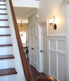 Wainscoting on wall and it looks like beadboard on the steps???