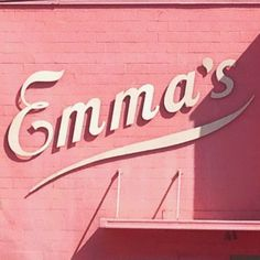 Emma's // Retro 1950's style cream lettering on a painting pink wall