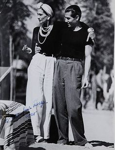 Coco Chanel with Serge Lifar, the principal dancer of Diaghilev's Ballets Russes during its final years in the late 1920's. black and white vintage fashion photo