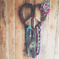 Hippie Dream Catcher.  Peace Love and Happiness.  Love the twist on the grape vine wreath.  Great way to recycle fabrics and trimmings.