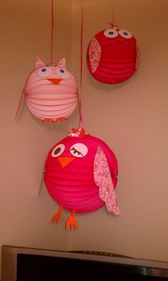 Owls from paper lanterns. Use scrapbook paper to cut out eyes, nose, wings, and feet. Hot glue and tie up with ribbon.
