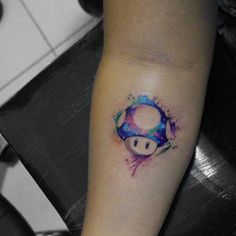 This Modern Tattoo Trend Is So Pretty #refinery29  http://www.refinery29.com/2016/04/109196/watercolor-tattoos#slide-9  One way to level up? A color-splattered mushroom from Mario's world....