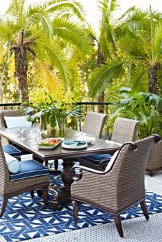 St. Martin captures the heritage of its namesake island, where a carefree tropical vibe mingles with old-world sophistication. Crafted of cast aluminum, the dining tables have remarkable turning and a hand-rubbed walnut finish that mimics the look of wood grain.