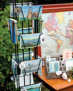Postcards of Martha's Vineyard serve as escort cards, displayed with a map of the couple's favorite places