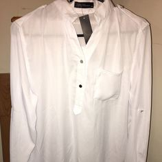 White sheer hi/low top. Brand new with tags. This top is brand new with tags, has snaps, and one snap on each arm to roll the sleeves to three quarter length sleeves. Front has a small pocket of the left side , and the length is high/low length. Size says XXL, but I couldn't fit into it, and I wear a large. So I would guess a size medium would fit into this, Tops Blouses