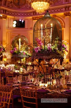 Fabulous Antique birdcage wedding centerpieces are filled with candles and pink blooms! #wedding #antique