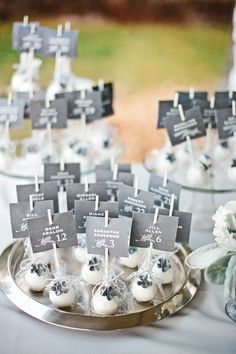 "Cake pop escort cards!!! have a sign ""something sweet to help you find you seat"""