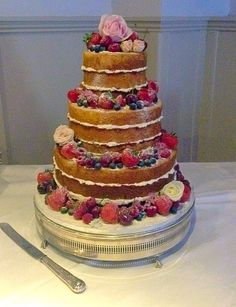 A gorgeous naked wedding cake with scrumptious summer fruits