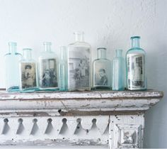 Photograps in a bottle!  I have some many of these blue bottles I will have to give it a try!