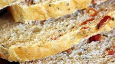 A deliciously light sandwich loaf studded with sweet basil and tart sundried tomatoes.