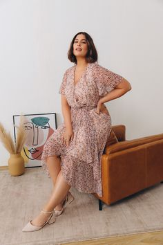 Printed Wrap Dress With Flutter Sleeves - Addition Elle - $99.95 Celebrate the arrival of summer with this stunning plus size wrap dress set with flutter sleeves. In addition to being lightweight and comfortable, this dress will instantly add style to your outfit of the day. All that's missing are heeled sandals and discreet jewelry.