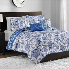 """Bring a pop of pattern to your master suite or guest room with this lovely reversible quilt set, showcasing a botanical-inspired motif in blue.  Product: 1 Queen comforter 2 Standard shams 1 Rectangular accent pillow1 Square accent pillowConstruction Material: PolyesterColor: BlueFeatures: Accent pillows include insertsDimensions: Rectangular Accent Pillow: 12"""" x 16""""Square Accent Pillow: 16"""" x 16""""Standard Sham: 20"""" x 26""""Queen Comforter: 90"""" x 90""""Note: Shams do not include insertsCleaning ..."""