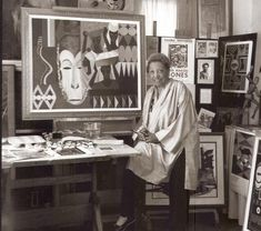 Loïs Mailou Jones (1905-1998) painting in her Paris studio in 1937 or 1938 as her cat hangs out on her shoulder. Born in Boston, her mother, Carolyn Dorinda Jones was a hat designer and a beautician, and her father, Thomas Vreeland Jones, was an office building superintendent before becoming a lawyer at age forty. Ms. Jones was encouraged by both parents to pursue art and she graduated from the School of the Museum of Fine Arts in Boston in 1927