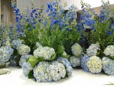 Blue delphinium, blue hydrangea centerpieces with Daevids of Norfolk
