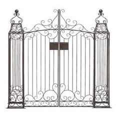Garden gate with ornate scrolling detail.  Product: GateConstruction Material: MetalColor: BronzeFeatures: Scrolling detailsDimensions: 60 H x 60 W x 9 DCleaning and Care: Wipe with a dry cloth