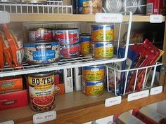 Cupboard organization with undershelf baskets and more.