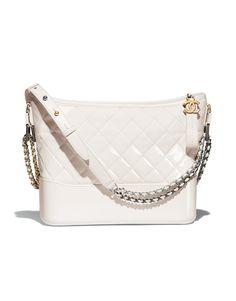 CHANEL'sGABRIELLE hobo bag, goatskin, patent goatskin, silver-tone & gold-tone metal-white - CHANEL