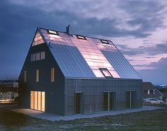 pfeifer roser kuhn architekten - patchwork house, a two family house in müllheim built in 2005 that is separated by a central hall covered in polycarbonate that circulates out hot air in the summer and stores solar heat in the winter.  ruedi walti.  #architecture #pfeiferroserkuhn #germany #fiberglass #house #plastic #translucent #müllheim #polycorbonate