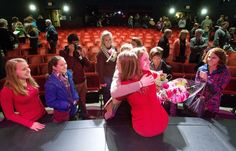 World photo/Don Seabrook:   Friends and family congratulate Washington State Apple Blossom royalty candidates after they were chosen Wednesday night at the Performing Arts Center including Gabe Mercer with her back to the camera.